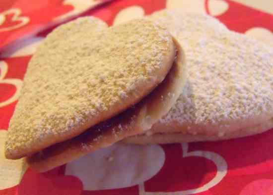 http://www.irishamericanmom.com/2012/02/14/almond-heart-raspberry-cookie-sandwiches