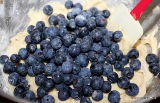 Adding blueberries to cake batter