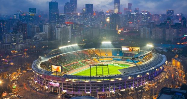 Bright lights  big city  bigger plans  Jim McGuinness in Beijing Beijing Guoan  Workers  Stadium  the club s ground  Photograph  Sino Getty
