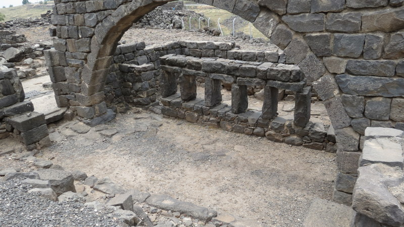 The structure next to the ritual bath, which includes arches.