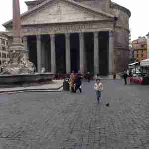 Boy playing soccer in front of the Pantheon on Christmas Eve morning 2014