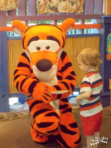Boy meeting Tigger at Disney World