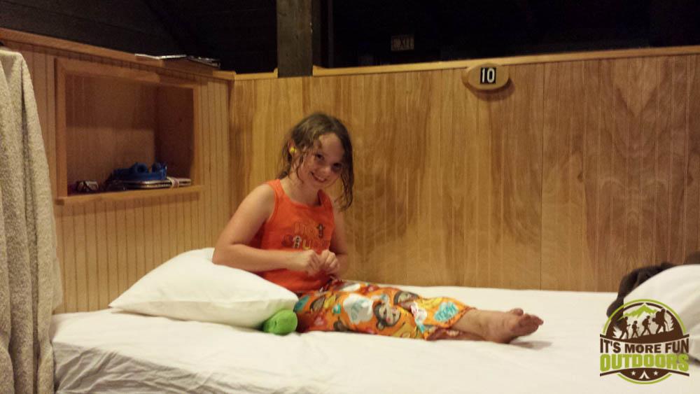 Dora, ready for bed in the Loft bunkroom (notice the ear plugs...they offer them...use them!) at the Adirondak Loj at Heart Lake, Lake Placid, NY, Adirondacks