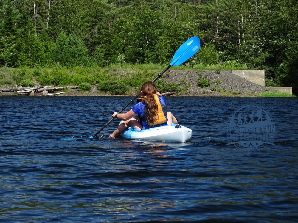 Dora, relaxing and having fun as we approach the canoe access. Henderson Lake Kayak Camping, Tahawus Hike!