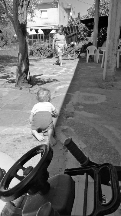Baby crawling towards grandmother
