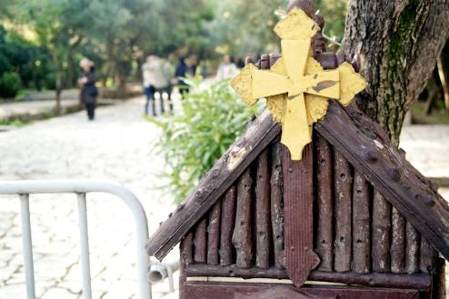 The top of a small shrine with a yellow cross.