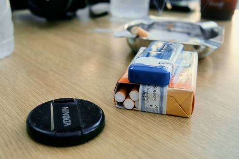 Still Life with Cigarettes and Lens Cap