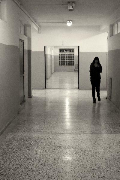 Girl walking in a corridor