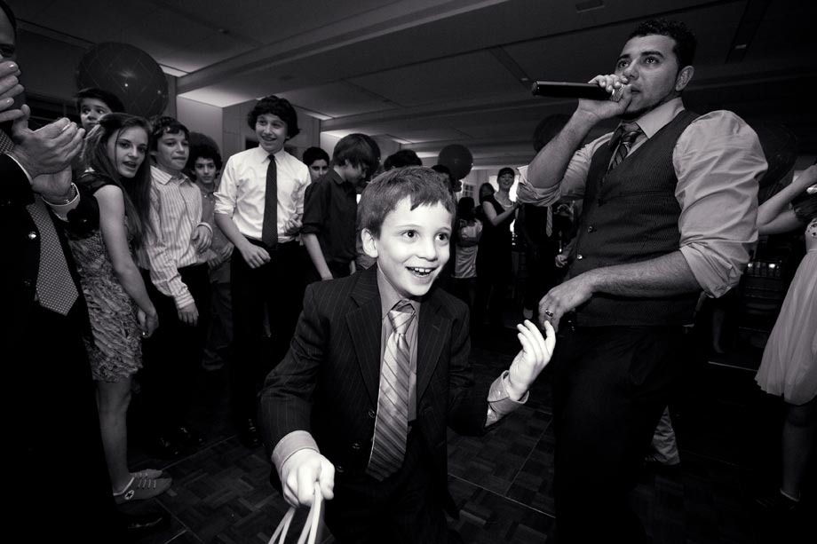 brother entering mitzvah party