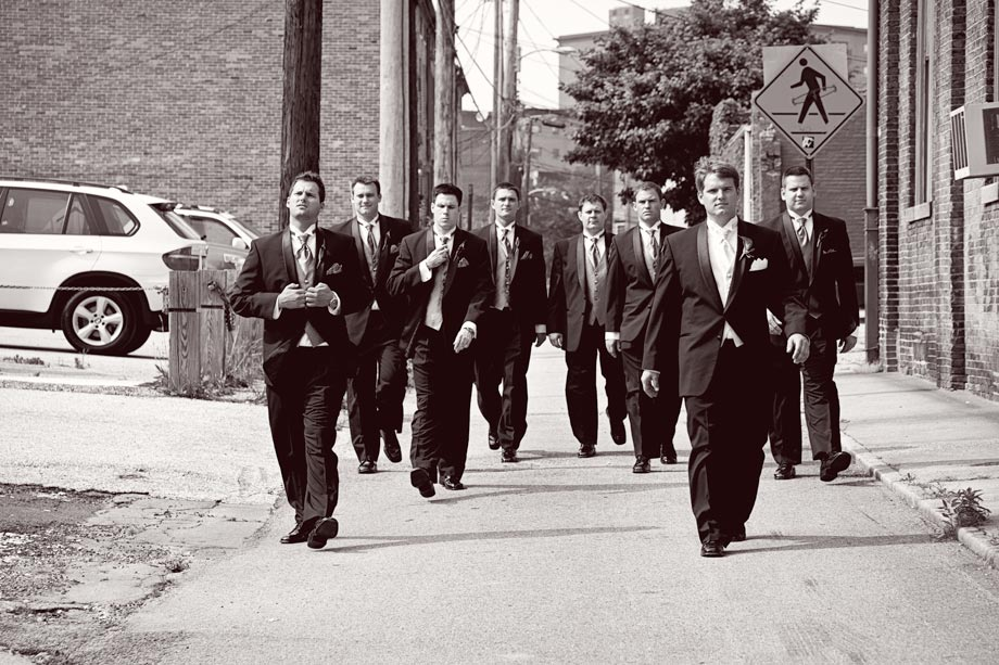 groomsmen walking down alleyway