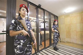 Lebanese policewomen stand guard at the entrance to the office of the Anadolu Agency in Beirut, Lebanon.