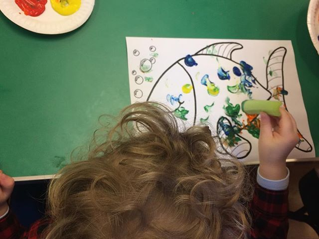 Painting fish with celery sticks at Toddler Group today