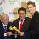 Real Madrid's soccer star Portuguese Cristiano Ronaldo receives the European Golden Shoe trophy from soccer legends Real Madrid's honorary president Di Stefano and Portuguese Eusebio during a ceremony in Madrid