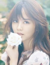The Beautiful Kim So Hyun Holding a White Flower