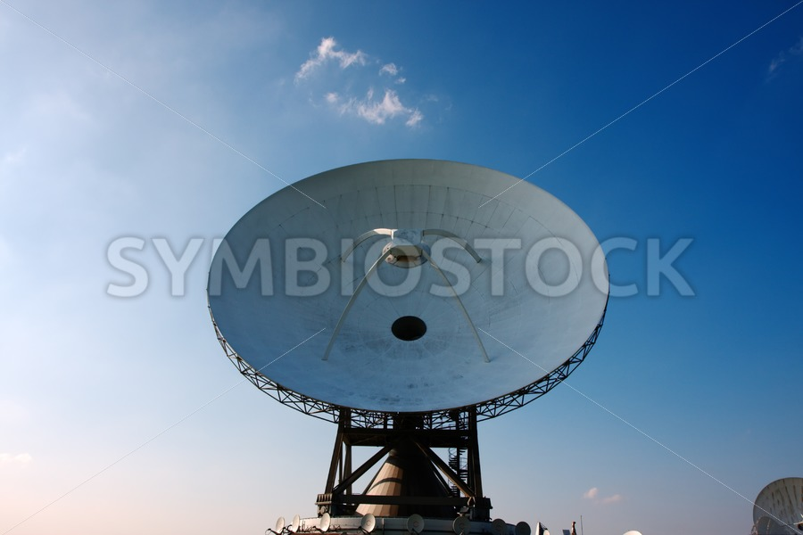 Communicating via satellite dishes - Jan Brons Stock Images
