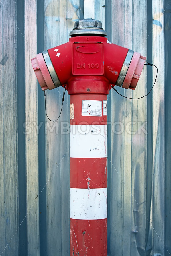 Fire hydrant steel wall - Jan Brons Stock Images