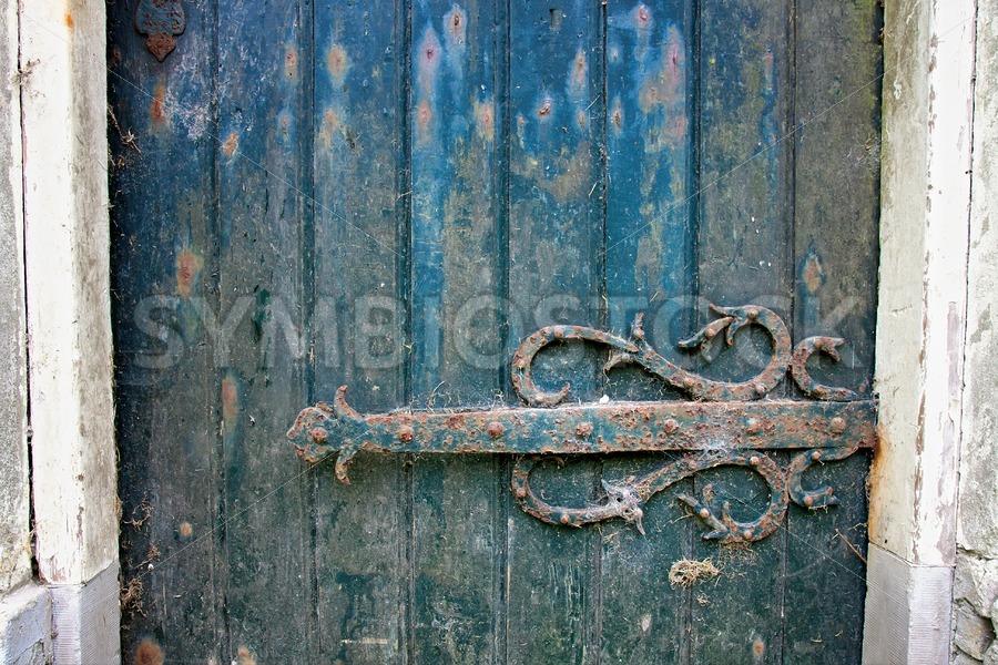 Old door hinge of ruined building - Jan Brons Stock Images