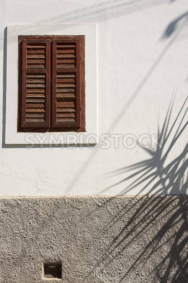 Shadows on old house - Jan Brons Stock Images
