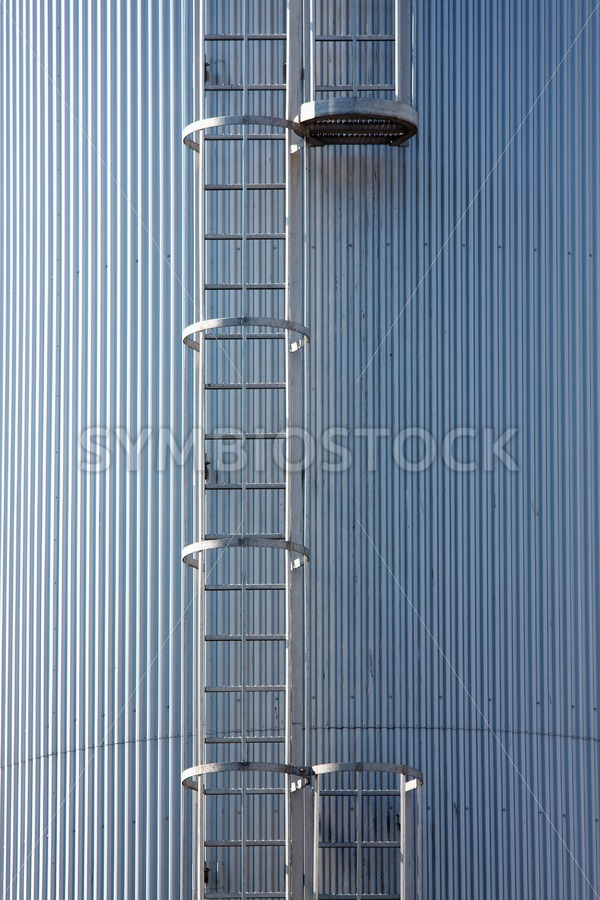 Silver blue silo with steel ladder. - Jan Brons Stock Images