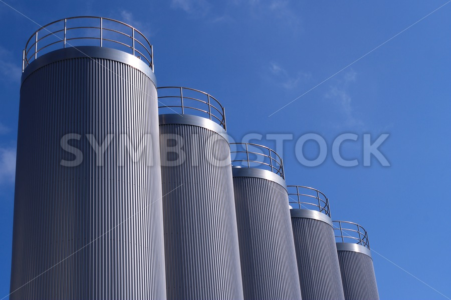 Silver blue silos - Jan Brons Stock Images