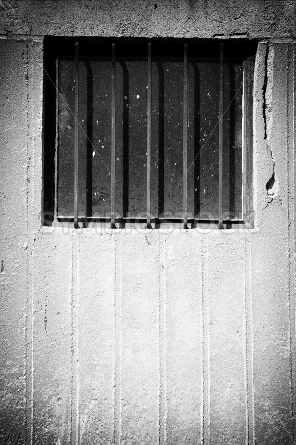Window bars concrete wall black white - Jan Brons Stock Images