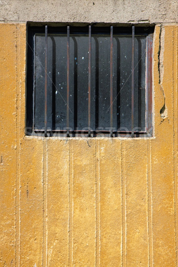 Window bars concrete wall - Jan Brons Stock Images