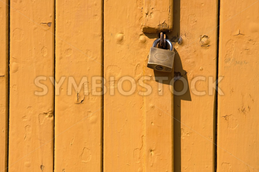 Wooden plank door steel lock - Jan Brons Stock Images