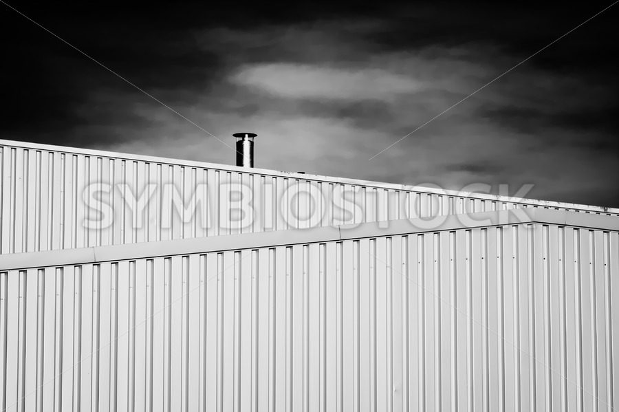 Air Pipe on steel building Black White - Jan Brons Stock Images