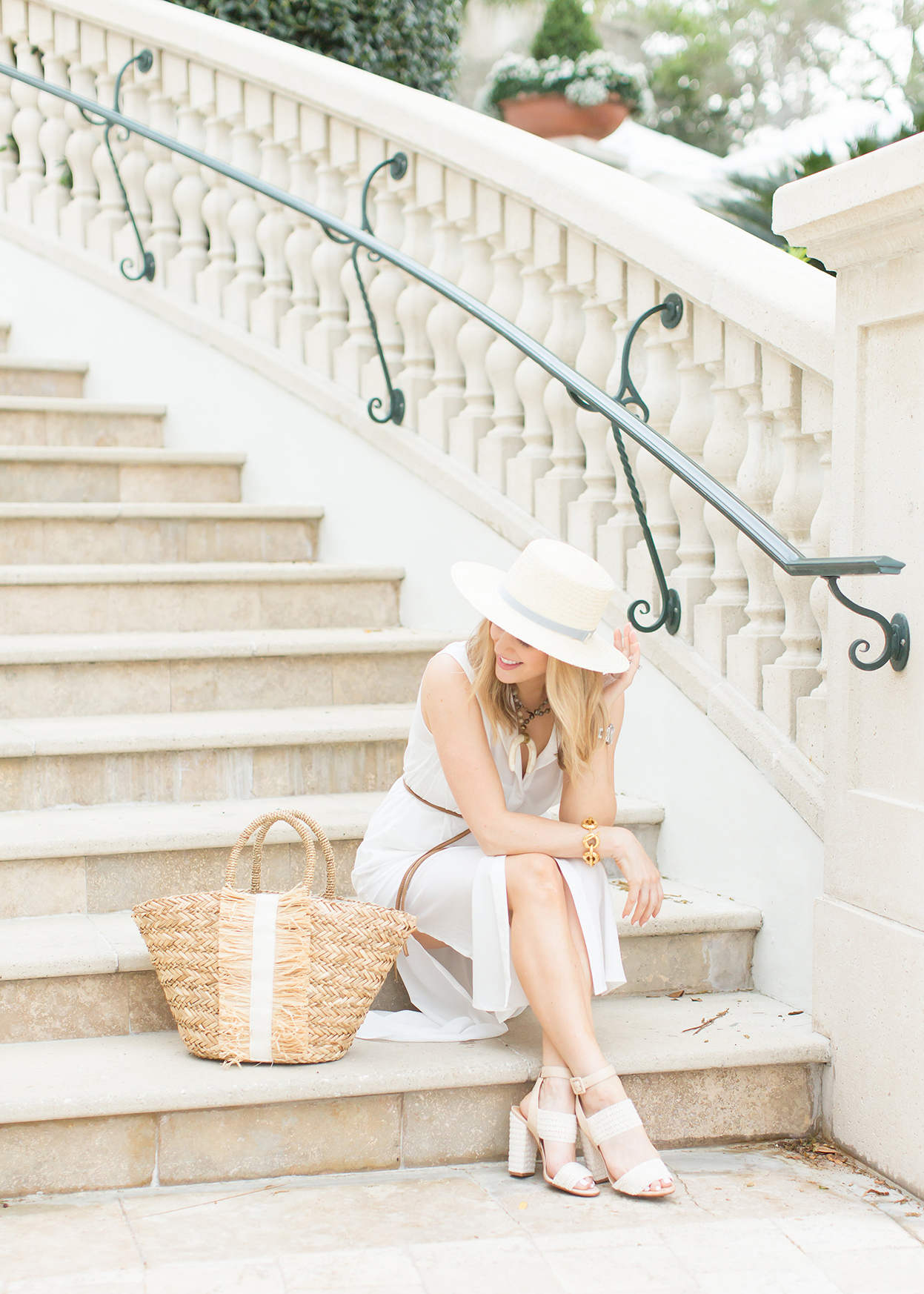 straw beach tote and a white beach dress