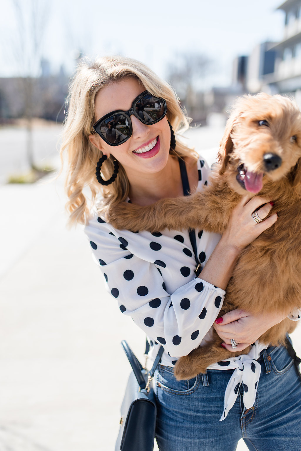 polka dot top and a golden doodle