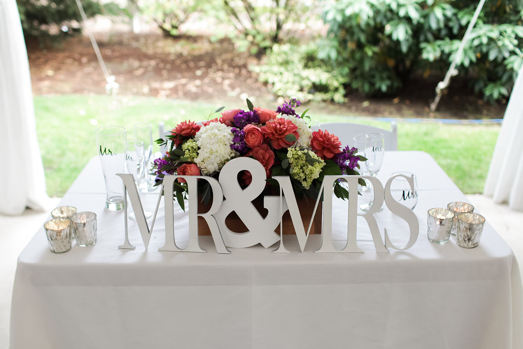 Sweetheart Table Centerpiece    flowers by Jen's Blossoms    photo by Kate Price Photography