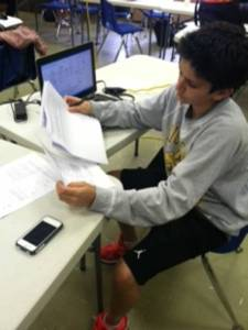 Freshman Brady Berman studiously works on the packets provided by his tutor to help prepare for the Earth Science Regents. To read more about private tutors, click the image above!