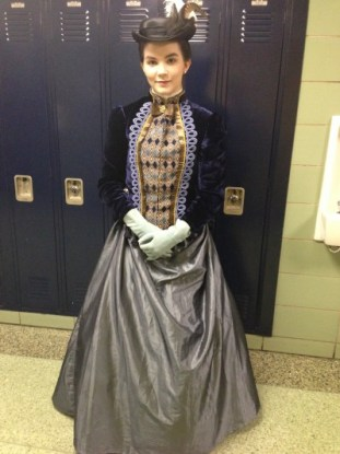 "Senior Julie Zeitoun dresses in traditional Victorian garb and said she has ""always wanted a handmade dress."" The dress was a gift from her mother, and she plans on wearing it for Thanksgiving and Christmas as well."