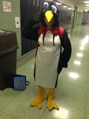 Junior Blake Wilen waddles down the hallway in her penguin costume.