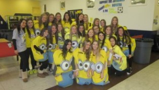 "Senior girls get silly by wearing oversized minion costumes from the popular movie ""Despicable Me."" ""It was really fun to wear but uncomfortable to sit down in!"" said senior Erica Levy."