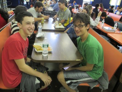 """Freshman Josh Weinstein (left.) What was the happiest moment of your life? """"When I met Eric Brett (right.)"""""""