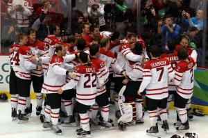 Team Canada celebrates after Sidney Crosby scores the game-winning goal in the gold medal game against Team USA in the 2010 Winter Olympics (Photo by Alex Livesey/Getty Images).