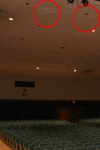 The areas circled in red are two of the regions in which the Auditorium ceiling is deteriorating.