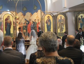 Mr. Anderle and Ms. Kakounis recite their vows in front of their cherished guests.
