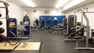 The new and improved weight room features an improved façade and modern machines.