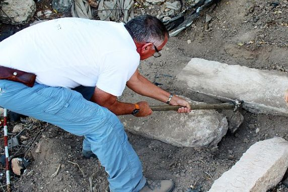 Aharoni Amitai helps uncover ancient gravestones with Aramaic and Greek inscriptions in the northern Israeli community of Tzipori.