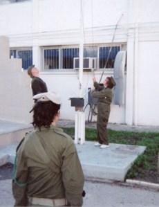 Gloria Schreiber raising the flag of Israel.