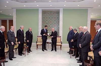 President al-Assad meets members of the national committee charged with drafting a new constitution.