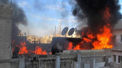 Embattled Baba Amr neighborhood in Homs, Syria, in flames.