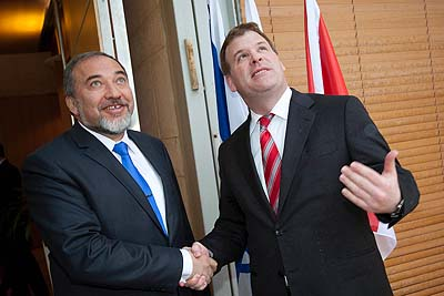 Canadian  Minister  of Foreign  Affairs  John  Baird shaking hands with Israel's Foreign Minister Avigdor Liberman in Jerusalem, February 1, 2012.