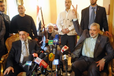 Muslim Brotherhood leader Mohammad Badie meets with Hamas Prime Minister Ismail Haniyeh