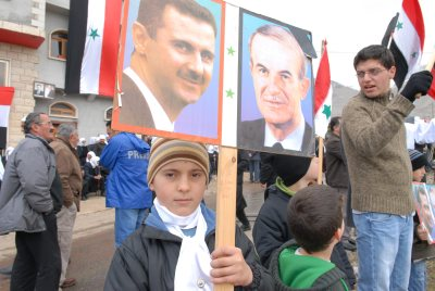 Supporters of the Assad family