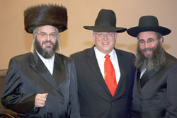 (L-R) Ohr HaChaim (Spiegel Shul) rav, Rabbi Shlomo Klein; attorney Howard Gluck; and Rav Nechemia Langer at the Spiegel Shul's melaveh malkah.