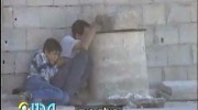 Jamal al-Dura and his 12-year-old son Muhammad under fire
