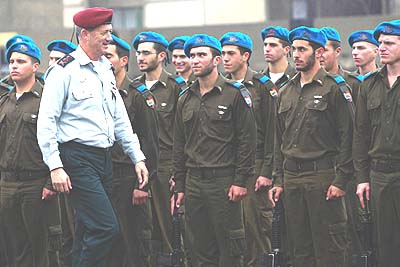 Israeli Chief of Staff Lt. Gen. Benny Gantz, left, attends an officers graduation ceremony.